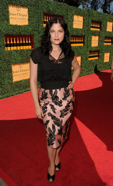 Selma Blair paired her black and pink print skirt with ladylike black peep-toe pumps.