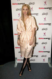Iggy Azalea hid her figure under a baggy peach utility jacket during the SuperFanFest show.