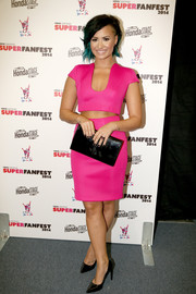 Demi Lovato showcased both abs and cleavage in a hot-pink Philip Armstrong crop-top at the SuperFanFest show.