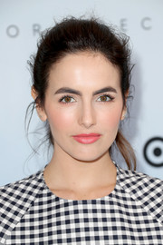 Camilla Belle swiped on some pink lipstick for a sweet beauty look.