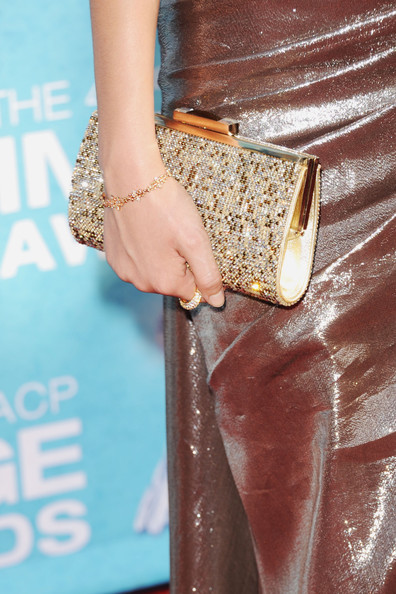Victoria Justice Gold Bracelet [clothing,fashion,dress,leather,street fashion,brown,beige,footwear,haute couture,fashion model,arrivals,victoria justice,fashion detail,california,los angeles,the shrine auditorium,naacp image awards]