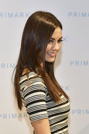 Victoria Justice wore her long hair loose and straight with a center part while celebrating Primark's fifth US store opening.