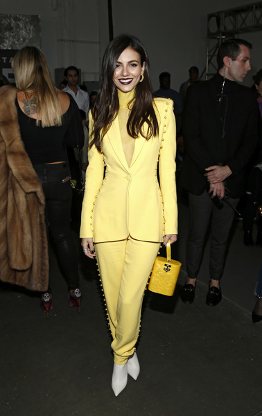 Victoria Justice Plastic Purse [clothing,fashion,yellow,fashion model,suit,pantsuit,outerwear,event,fashion show,blazer,pamella roland,victoria justice,front row,new york city,pier 59,new york fashion week,fashion show]