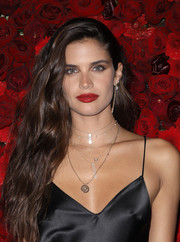 Sara Sampaio injected a bright pop of color with a swipe of red lipstick.