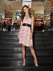 Taylor Hill was pretty as a picture in her drapey Balenciaga floral frock while launching the Easy Collection from Body by Victoria.