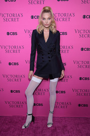 Elsa Hosk was business-chic (well, from mid-thighs up) in a navy pinstriped skirt suit at the 2017 Victoria's Secret fashion show viewing party.
