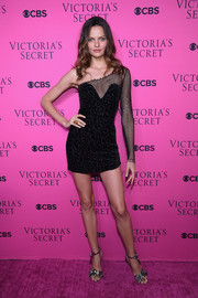 Barbara Fialho was equal parts sultry and edgy in a sheer-panel one-shoulder LBD by Maison Alexandrine at the 2017 Victoria's Secret fashion show viewing party.