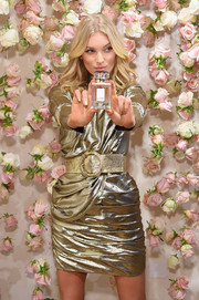 Elsa Hosk played up her tiny waist with an oversized metallic belt at the LOVE fragrance celebration.