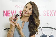 Lily Aldridge styled her simple gray top with a chic pair of sterling collar necklaces.