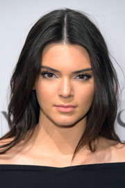 Kendall Jenner left her locks loose in sexy center-parted layers when she attended the 'Angel' book launch.