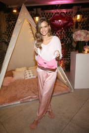 Josephine Skriver kept it cute and relaxed in a loose pink V-neck sweater at the Victoria's Secret Ultimate Girls Night In.