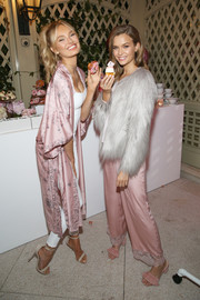 Josephine Skriver glammed up her pajamas with a silver fur jacket for the Victoria's Secret Ultimate Girls Night In.
