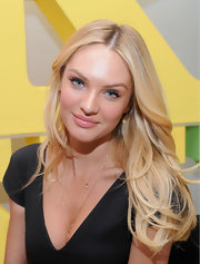 Candice Swanepoel wore her blond tresses parted down the center and styled in long loose waves while promoting Victoria's Secret.