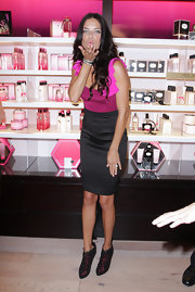 Adriana Lima attended the Victoria's Secret Fashion's Night Out soiree in black and bright pink ankle boots.