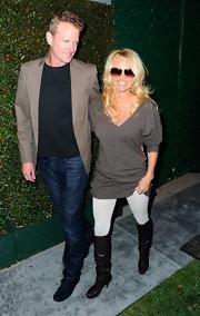 "Pamela Anderson went casual at the premiere of Paul McCartney's ""My Valentine"" music video in this sweater tunic and boots."