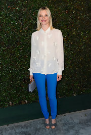 Amy Smart loves proper styles like this collared applique blouse.