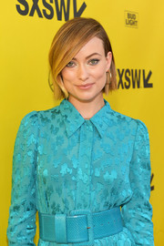 Olivia Wilde cinched in her turquoise dress with a matching oversized belt for the 2018 SXSW premiere of 'A Vigilante.'