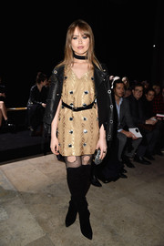 Kristina Bazan completed her rocker-glam ensemble with black over-the-knee boots and torn fishnet stockings.