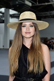Kristina Bazan attended the Viktor & Rolf Couture show looking summer-chic in her straw hat.