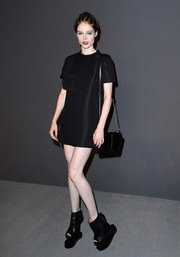 Coco Rocha sealed off her all-black look with a chain-strap bag.