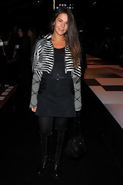 Margherita Missoni finished off her look in edgy style with a pair of knee-high black lace-up boots.