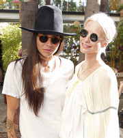 Poppy Delevingne accessorized with hippie-chic round sunnies for the Villoid garden tea party.