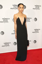 Zoe Kravitz turned up the heat in a cleavage-baring black column dress by Alexander Wang at the Tribeca Film Fest premiere of 'Vincent N Roxxy.'