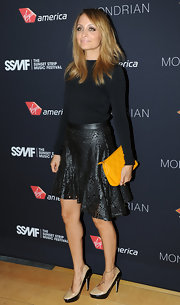 Nicole's tough-luxe leather skirt looked extra-feminine with laser-cut floral detailing.