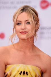 Laura Whitmore attended the 2017 Virgin TV BAFTA Television Awards wearing a loose bun with wavy tendrils.