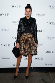 Giovanna Battaglia looked fashionably ready for fall in a paillette-embellished leather jacket during the Visionary World of Vogue Italia exhibition.