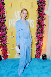 Rosie Huntington-Whiteley chose a slouchy blue pinstriped coat by Galvan for the Vital Proteins Collagen Water launch.