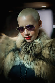 Amber Rose topped off her fur clad look with gold stunner shades and hot red lipstick.