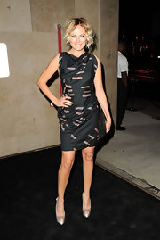 Malin Akerman gave her geometric print LBD with a sleek black patent leather envelope clutch.