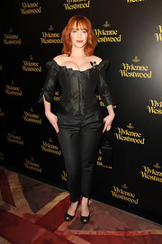 Christina Hendricks kept her look monochromatic with a pair of black lace platform peep toes.