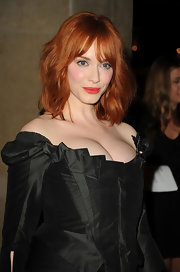 Actress Christina Hendricks always stand out in a crowd with her fiery red locks. The starlet kept her 'do low key with a straight style and wispy bangs.