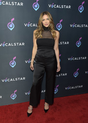 Katharine McPhee paired her top with high-waisted satin pants.