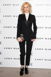 Eva Herzigova teamed her suit with a pair of black booties.