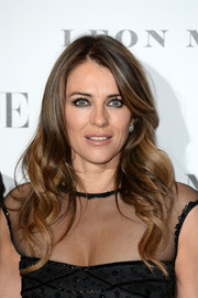 Elizabeth Hurley looked as lovely as ever with her long wavy tresses at the Vogue 100: A Century of Style event.