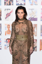 Kim Kardashian accentuated her waist with an oversized beige leather belt when she attended the Vogue 100 Festival Gala.