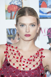 Lily Donaldson opted for a no-frills center-parted bun when she attended the Vogue 100 Festival Gala.