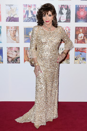 Joan Collins got all glitzed up in a gold sequin gown for the Vogue 100 Festival Gala.