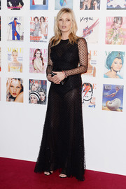 Kate Moss was all about sexy glamour in a sheer, dotted black gown by Alexander McQueen at the Vogue 100 Festival Gala.