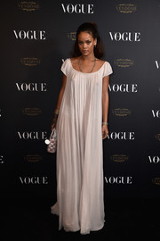 Rihanna wore a see-through long pale pink chiffon dress by Christian Dior to the 'Vogue' 95th anniversary party in Paris.