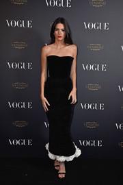 Kendall attended the Vogue 95th Anniversary Party in a black, strapless gown with white trip.