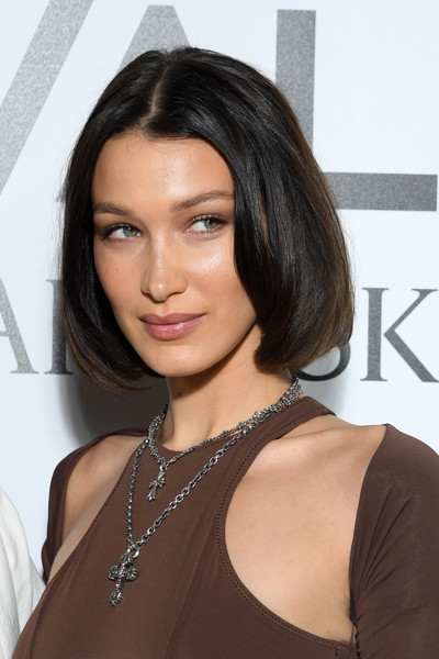 Bella Hadid styled her outfit with a pair of silver cross pendants by Chrome Hearts.