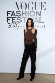 Bella Hadid attended the Vogue Fashion Festival 2019 wearing a fitted brown cold-shoulder top by Alexander Wang.