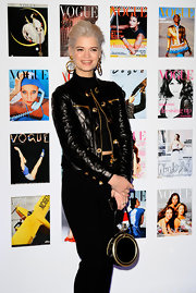 Pixie Geldof took some style cues from Donatella in this gold-adorned leather number.