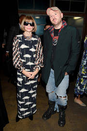 Anna Wintour donned a cloud-print maxi dress with contrast sleeves for the Vogue Forces of Fashion conference.