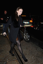 Eleonora Abbagnato arrived at Milan Fashion Week in her classic black pumps.