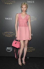 Soo Joo Park was flirty in a pink mini dress with a sheer lace bodice at the Vogue party in Paris.
